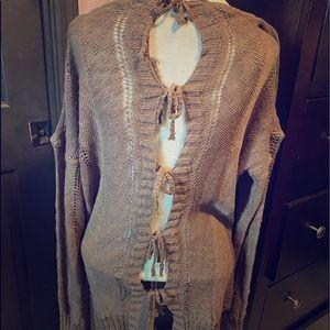 Cocoa colored, open stitch, open back sweater.